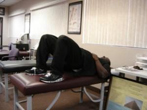 Bridging exercises for back strength. Two feet apart.